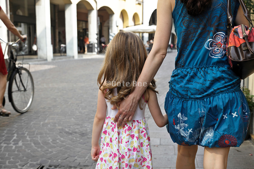 mother with child walking in the street