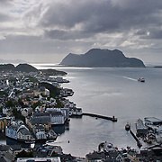 Three weeks aboard the Kong Harald. Hurtigruten, the Coastal Express. The city of Alesund, the view of a Hurtigruten ship entering the harbour from Fjellstua.