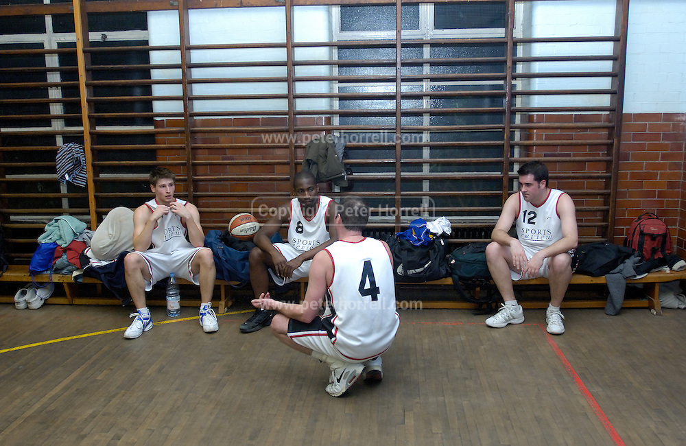Erkenwald's Adrian Leclair (on left), Martin Overare (#8), Declan McCusker (#4) and Richard Williams (#12)) sit at the side of the court during a time out in Erkenwald's EMBL game at Eastbury Tigers on Thursday 9th February. This was Tigers' last home game at the Dawson Avenue gym since the School was closing the following day.