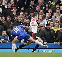 Photo: Lee Earle.<br /> Chelsea v Fulham. The Barclays Premiership. 26/12/2005. Chelsea's Joe Cole (L) fouls Brian McBride in the penalty box