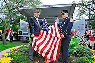 Holding American Flag that had been draped over 9/11 monument made with steel from World Trade Center, at the Merrick Post #1282 American Legion Tenth Annivesary of 9/11 event, are American Legion Adjutant Robert Tom Riordan PCC and North Merrick Fire Dept. Ex. Chief Henry Hinrichs, at Merrick Veterans Memorial Park, Merrick, New York, USA, on September 11, 2011.