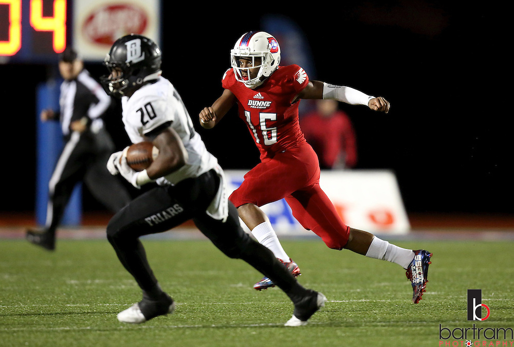 Bishop Dunne's Jason Sasser chases Bishop Lynch running back Jermaine Mask during the TAPPS Division I state championship game on Saturday, Dec. 3, 2016 at Panther Stadium in Hewitt, Texas. Bishop Lynch High School won 21-17. (Photo by Kevin Bartram)