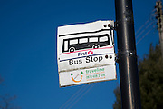 Bus stop sign damaged by collision