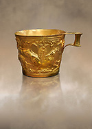 Vapheio type Mycenaean gold cup depicting a wild bull hunt side D, Vapheio Tholos Tomb, Lakonia, Greece. National Archaeological Museum of Athens. <br /> <br />  Two masterpieces of Creto - Mycenaean gold metalwork were excavated from a tholos tomb near Lakonia in Sparta in 1988. Made in the 15th century BC, the gold cups are heavily influenced by the Minoan style that was predominant in the Agean at the time. The bull hunt was popular with  Mycenaean  and Minoan artists and symolised power and fertility. The distinctive shape of the cup is kown as 'Vapheio type'. .<br /> <br /> If you prefer to buy from our ALAMY PHOTO LIBRARY  Collection visit : https://www.alamy.com/portfolio/paul-williams-funkystock/mycenaean-art-artefacts.html . Type -   Athens    - into the LOWER SEARCH WITHIN GALLERY box. Refine search by adding background colour, place, museum etc<br /> <br /> Visit our MYCENAEN ART PHOTO COLLECTIONS for more photos to download  as wall art prints https://funkystock.photoshelter.com/gallery-collection/Pictures-Images-of-Ancient-Mycenaean-Art-Artefacts-Archaeology-Sites/C0000xRC5WLQcbhQ