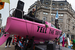 A DJ entertains the crowd as hundreds of environmental protesters from Extinction Rebellion occupy Oxford Circus, a pink yacht being the focal point of their presence, with traffic denied access to two of London's busiest streets. London, April 16 2019.