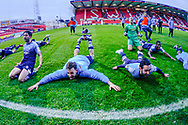 The Woking players slide across the pitch to the fans during the The FA Cup 2nd round match between Swindon Town and Woking at the County Ground, Swindon, England on 2 December 2018.