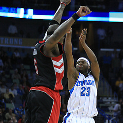06 February 2009:  New Orleans Hornets guard Devin Brown (23) shoots a three point in the fourth quarter over Toronto Raptors center Jermaine O'Neal (6) during a 101-92 win by the New Orleans Hornets over the Toronto Raptors at the New Orleans Arena in New Orleans, LA.