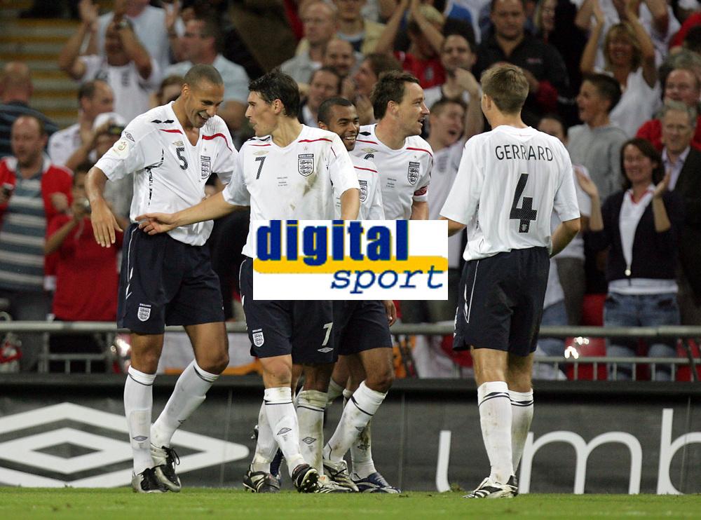 Photo: Rich Eaton.<br /> <br /> England v Russia. UEFA European Championships Qualifying. 12/09/2007. England's Rio Ferdinand (L) celebrates scoring the 3rd goal of the night.