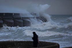 © Licensed to London News Pictures. 27/10/2013. BRIGHTON, UK. Waves crash against the marina walls. Waves at Brighton seafront this morning as Britain was braced for the worst storm for a decade today, which is set to bring driving rain and winds of up to 90mph to some areas. Photo credit : LNP