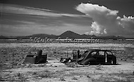 """Taken while heading East on Interstate 10 somewhere east of Las Cruces, New Mexico and El Paso, Texas.  More of nature proving man's incapacity to win against the elements.  20"""" x 12"""".  Printed on Parrot Digigraphic Ultra Lustre Photopaper.  Limited Edition of 25."""