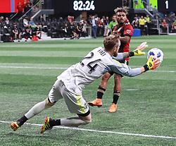 July 15, 2018 - Atlanta, GA, USA - Seattle Sounders goalkeeper Stefan Frei blocks a shot as Atlanta United midfielder Josef Martinez looks on during the second half on Sunday, July 15, 2018, in Atlanta, Ga. (Credit Image: © Curtis Compton/TNS via ZUMA Wire)