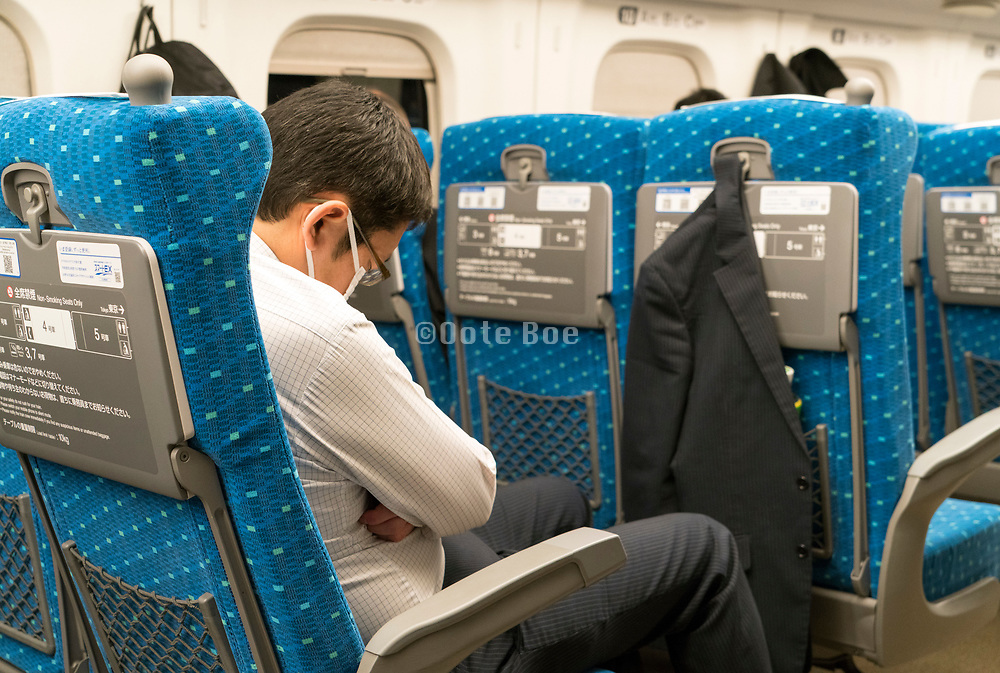 business people in the Shinkansen bullet train Japan