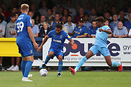 AFC Wimbledon striker Andy Barcham (17) taking on Coventry City defender Dujon (Dujoin) Sterling (17) during the EFL Sky Bet League 1 match between AFC Wimbledon and Coventry City at the Cherry Red Records Stadium, Kingston, England on 11 August 2018.