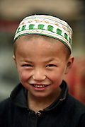 A Hui boy in Korla in China's western Xinjiang province. The Hui minority are descended from the Arab and Iranian traders who traveled to China during the Tang Dynasty. Immigrants from Central Asia increased their numbers during the Yuan Dynasty.