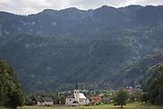 A rural Slovenian community church and village near Lake Bled, on 18th June 2018, in Bohinjska Bela, Bled, Slovenia.