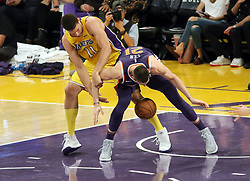 November 17, 2017 - Los Angeles, California, U.S - Lakers Brook Lopez battles for this loose ball against Suns  Alex Len during the contest as the host Los Angeles Lakers  fall to the visiting Phoenix Suns 122-113 on Friday,  November 17, 2017 at the Staples Center in Los Angeles,  California. (Credit Image: © Prensa Internacional via ZUMA Wire)