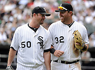 CHICAGO - JULY 27:  John Danks #50 talks wtih Adam Dunn #32 of the Chicago White Sox during the game against the Detroit Tigers on July 27, 2011 at U.S. Cellular Field in Chicago, Illinois.  The White Sox defeated the Tigers 2-1.  (Photo by Ron Vesely)  Subject: John Danks;Adam Dunn