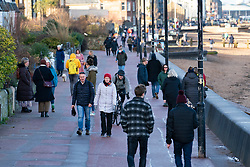 Portobello, Scotland, UK. 16 January 2020.  Despite national lockdown and today's tightening of restrictions on the serving of takeaway food and social gatherings, Portobello promenade and beach proved as popular as ever on Saturday afternoon with many members of the public travelling there to walk and visit cafes that offer takeaway food and drinks. No police patrols were evident. Iain Masterton/Alamy Live News