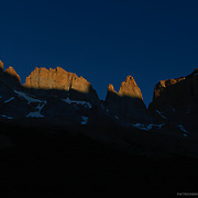 Peaks in Torres del Paine as the sun sets in Valle Frances in Patagonia, Chile.