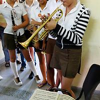 Central America, Cuba, Santa Clara. Girl playing trumpet at the Santa Clara Musical School of Art.