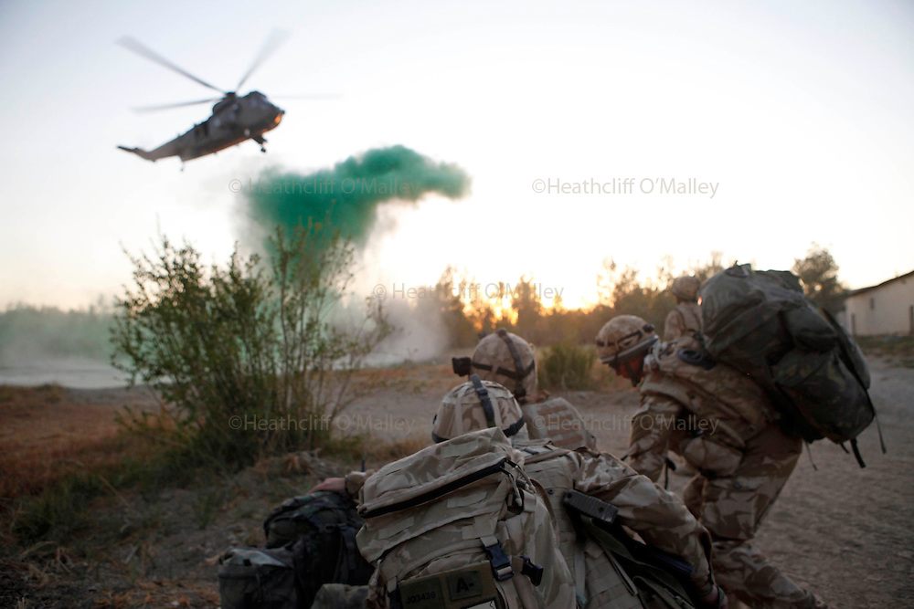 Mcc0018106 . SundayTelegraph..Soldiers from the Grenadier Guards preparing to get on a SeaKing helicopter out of FOB Shahzad, Helmand province...Afghanistan 14 November 09.
