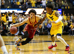 Feb 24, 2018; Morgantown, WV, USA; Iowa State Cyclones guard Lindell Wigginton (5) drives against West Virginia Mountaineers guard Daxter Miles Jr. (4) during the first half at WVU Coliseum. Mandatory Credit: Ben Queen-USA TODAY Sports