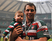 Guinness Premiership Final. Leicester Tigers vs Saracens. Louis Deacon of Leicester Tigers celebrates with his daughter Marley after the Guinness Premiership Final at Twickenham Stadium, London, England on the 29th May 2010. Photo Michael Paler / PHOTOSPORT