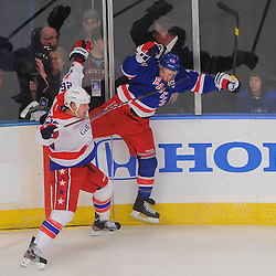 April 7, 2012: Washington Capitals left wing Matt Hendricks (26) and New York Rangers right wing Ryan Callahan (24) collide in the corner during first period NHL hockey action between the Washington Capitals and the New York Rangers at Madison Square Garden in New York, N.Y.