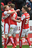 Chris Burke of Rotherham United celebrates with Rotherham United midfielder Danny Ward and Rotherham United midfielder Richard Smallwood  scoring to go1 all  during the Sky Bet Championship match between Rotherham United and Charlton Athletic at the New York Stadium, Rotherham, England on 30 January 2016. Photo by Ian Lyall.