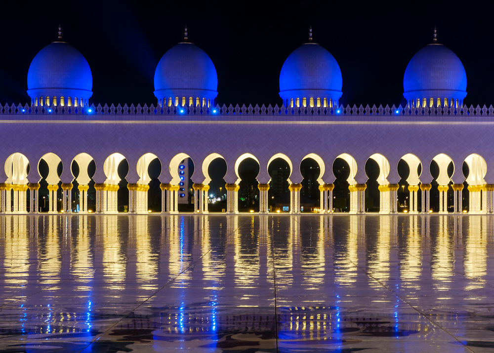 UNITED ARAB EMIRATES, ABU DHABI - CIRCA JANUARY 2017: View of the Inner Court Yard domes and cupolas at night of the Sheikh Zayed Mosque