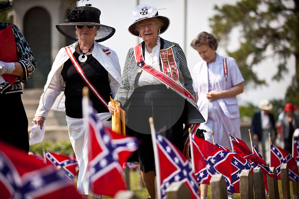 June Wells (C) leader of the Daughters of the Confederacy leads a procession at Magnolia Cemetery to mark Confederate Memorial Day on May 10, 2011 in Charleston, South Carolina.  South Carolina is one of three states that marks the day as a public holiday.