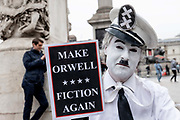 "A male mime artist with a placard reading Make Orwell Fiction Again"" during a demonstration against U.S. President Donald Trumps state visit to the U.K on the 4th June 2019 in London in the United Kingdom. Day two of President Trumps three-day state visit, which includes lunch with the Queen, a State Banquet at Buckingham Palace as well as business meetings with the Prime Minister and the Duke of York, before travelling to Portsmouth to mark the 75th anniversary of the D-Day landings."