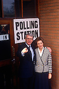John Major poses outside his constituency polling station with wife Norma, seeking re-election after replacing Margaret Thatcher