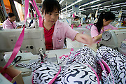 Chinese seamstresses at work sewing zebra print bras in the Top Form factory in Longnan, China