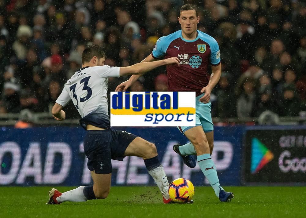 Football - 2018 / 2019 Premier League - Tottenham Hotspur vs. Burnley<br /> <br /> Ben Davies (Tottenham FC)  gets across to block Chris Wood (Burnley FC) at Wembley Stadium.<br /> <br /> COLORSPORT/DANIEL BEARHAM