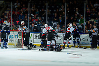 KELOWNA, BC - JANUARY 3:  Ice officials try to break up a dog pile between the Kelowna Rockets and the Victoria Royals at Prospera Place on January 3, 2020 in Kelowna, Canada. (Photo by Marissa Baecker/Shoot the Breeze)