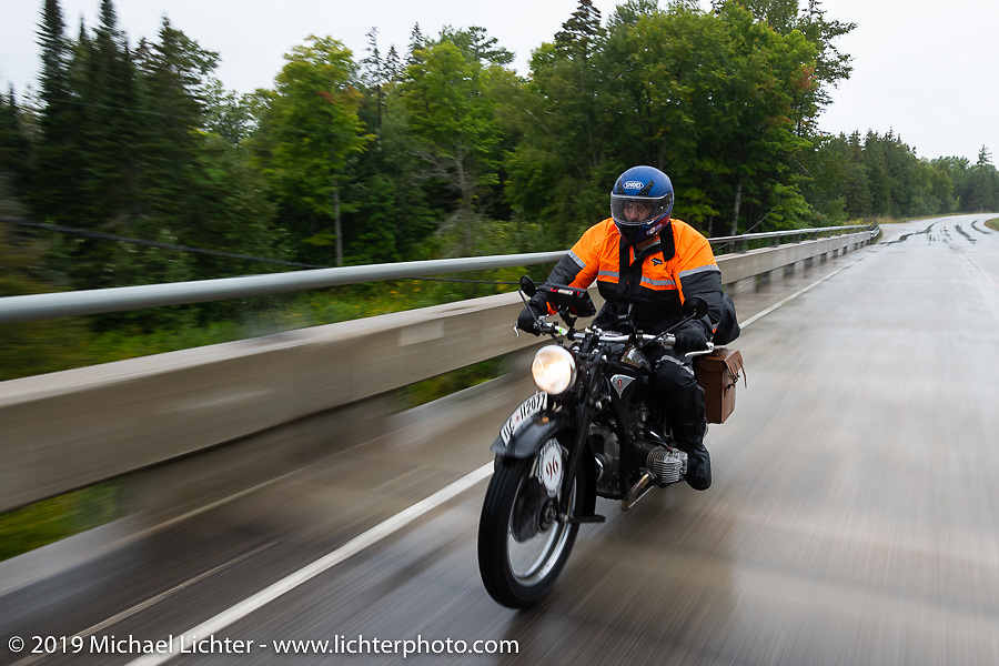 Richard Campbell riding through the rain during the Cross Country Chase motorcycle endurance run from Sault Sainte Marie, MI to Key West, FL. (for vintage bikes from 1930-1948). Stage 1 from Sault Sainte Marie to Ludington, MI USA. Friday, September 6, 2019. Photography ©2019 Michael Lichter.