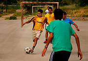 A group of young Moroccans meet every morning in one of Fes's many public parks to play their national sport, football. This particular morning was Monday, May 28, 2007. (PHOTO BY TIMOTHY  D. BURDICK)
