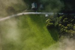 THEMENBILD - eine Wiese im Sonnenlicht und Bauernhaeuser neben einer Strasse im Sonnenlicht und Morgennebel, aufgenommen am 26. August 2019 in Kaprun, Oesterreich // a meadow in sunlight and farm houses next to a road in sunlight and morning fog in Kaprun, Austria on 2019/08/26. EXPA Pictures © 2019, PhotoCredit: EXPA/ JFK