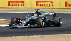 Mercedes' Lewis Hamilton during the 2018 British Grand Prix at Silverstone Circuit, Towcester. PRESS ASSOCIATION Photo. Picture date: Sunday July 8, 2018. See PA story AUTO British. Photo credit should read: Martin Rickett/PA Wire. RESTRICTIONS: Editorial use only. Commercial use with prior consent from teams.