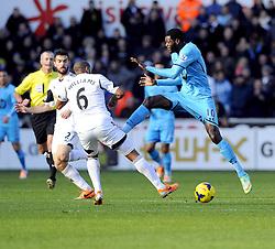 Tottenham Hotspur's Emmanuel Adebayor clashes with Swansea City's Ashley Williams - Photo mandatory by-line: Joe Meredith/JMP - Tel: Mobile: 07966 386802 19/01/2014 - SPORT - FOOTBALL - Liberty Stadium - Swansea - Swansea City v Tottenham Hotspur - Barclays Premier League
