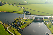Nederland, Groningen, Gemeente Zuidhoorn, 08-09-2009; Lammerburen, gemaal De Waterwolf aan het Reitdiep; het gehucht is beter bekend onder de naam Electra. Het gemaal, in beheer bij waterschap Noorderzijlvest, zorgt voor de afvoer van water naar het Lauwersmeer.<br /> Lammerburen with pumping station the Water Wolf at the Reitdiep, the hamlet is better known as Electra.<br /> luchtfoto (toeslag op standaard tarieven);<br /> aerial photo (additional fee required);<br /> copyright © foto/photo Siebe Swart