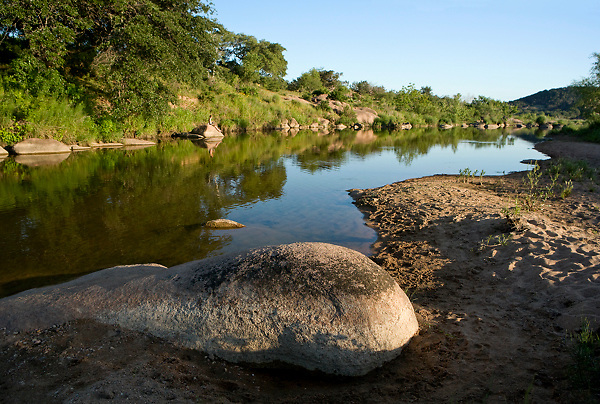 Stock photo of the sandy banks of a small river in the Texas Hill Country