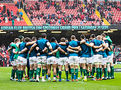 Ireland players huddle during the pre match warm up<br /> <br /> Photographer Simon King/Replay Images<br /> <br /> Six Nations Round 5 - Wales v Ireland - Saturday 16th March 2019 - Principality Stadium - Cardiff<br /> <br /> World Copyright © Replay Images . All rights reserved. info@replayimages.co.uk - http://replayimages.co.uk