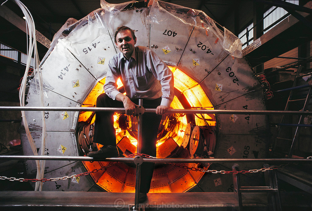 Physics: Geneva, Switzerland/CERN: L-3 Experiment. Russian scientist Yuri Kamishkou seen with the Hadron Calorimeter. CERN is the European centre for particle physics near Geneva. L3 is one of 4 giant particle detectors at the LEP Collider. The L-3 experiment is part of CERN's Large Electron- Positron Collider (LEP), inaugurated on 13 November 1989. LEP collides electrons & positrons accelerated to an energy of 50 GeV in a circular tunnel 100m underground & 27km in circumference. L3 is a cylindrical assembly of many types of apparatus - hadron & electromagnetic calorimeters, drift chambers, & a time projection chamber - which fit together like layers of an onion around the point where the particles collide. L3 is a collaboration of 460 physicists from institutions in 13 countries. MODEL RELEASED [1988]
