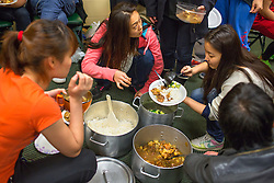 """Ringling Brothers in Fairfax, Va.Members of the China National Acrobatic Troupe share a meal before a performance in Fairfax, Va. The troupe travels with their own personal cook who supplies them with authentic Chinese food during their tour. <br /> <br /> Ringling Bros. and Barnum & Bailey Circus started in 1919 when the circus created by James Anthony Bailey and P. T. Barnum merged with the Ringling Brothers Circus. Currently, the circus maintains two circus train-based shows, the Blue Tour and the Red Tour, as well as the truck-based Gold Tour. Each train is a mile long with roughly 60 cars: 40 passenger cars and 20 freight. Each train presents a different """"edition"""" of the show, using a numbering scheme that dates back to circus origins in 1871 — the first year of P.T. Barnum's show."""