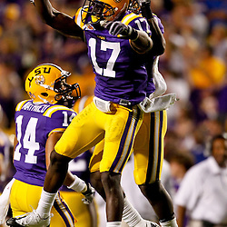 October 16, 2010; Baton Rouge, LA, USA; LSU Tigers cornerback Morris Claiborne (17) celebrates with cornerback Patrick Peterson (7) after an interception against the McNeese State Cowboys during a game at Tiger Stadium. LSU defeated McNeese State 32-10. Mandatory Credit: Derick E. Hingle