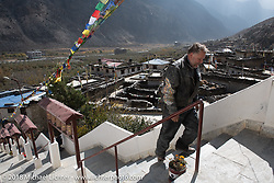 Kelly Modlin waling up to the Buddhist monastery in Marpha on day-5  of our Himalayan Heroes adventure riding from Kalopani through the Mustang District to our highest elevation of the trip at over 12,000' when we reached Muktinath, Nepal. Saturday, November 10, 2018. Photography ©2018 Michael Lichter.