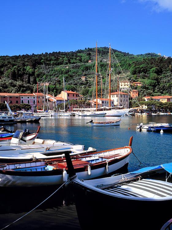 Small boats line the harbor at La Specia, Liguria, Italy.