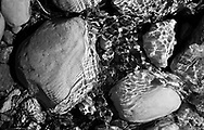 Temporary Textures on Rock -  A series of black and white infrared images exploring the textures of rocks and the light cast on them through water on sunny days...For more see here:..http://www.joshhawkins.com/2010/03/28/the-basis-temporary-textures-on-rocks/
